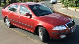 Skoda Octavia 1.9 TDI Elegance - Dark red, well cared for car with many extras