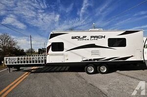 2010 wolfpack toyhauler in great condition with upgrated deck