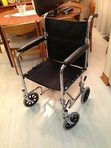 TRANSPORT WHEEL CHAIR MAKE BY AMG