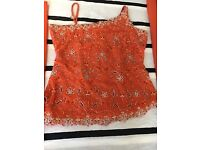 Orange beautifully cut embroidered Indian suit.