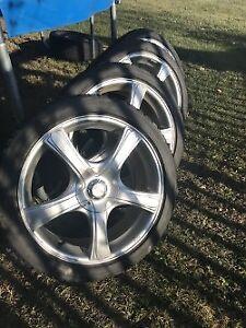 4 x Used Bridgestone Blizzak Snow Tires on Alloy Rims.