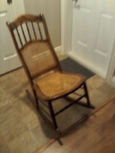 antique caned rocking chair in excellent condition can deliver