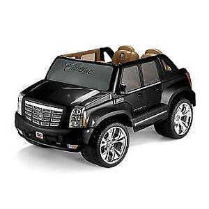 Power wheels Cadillac black for kids