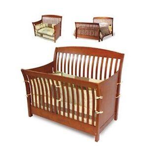 Solid wood crib. ap industry conversion kit included