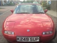Red Mazda Eunos Convertible, 1600cc, 1999.