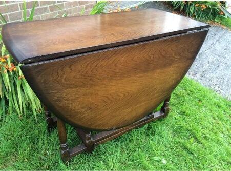 Vintage solid oak priory drop leaf extending drop leaf table