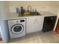 Stainless steel kitchen sink & tap, worktop & units