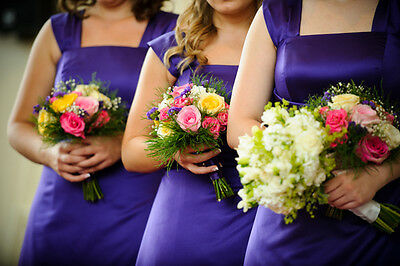 Purple bridesmaid dresses.