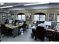 Bright and open desk space in office with filmmakers, animators and creatives