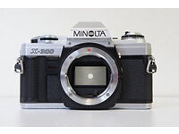 Minolta X-300 Camera with accessories (such as different lenses, flash, carry bag, ring adapter