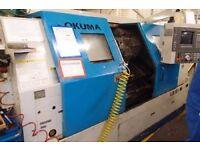 OKUMA MODEL LB 15 11M CNC 3 AXIS LATHE YEAR 1995