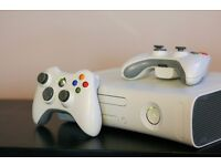 Selling Two Xbox 360's 2 controllers, a few games and one power cord