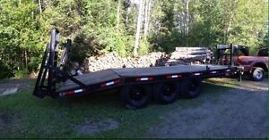 24 foot tri-axle trailer can carry up to 30000 lbs