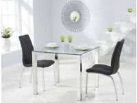 X4 dining chairs and glass table