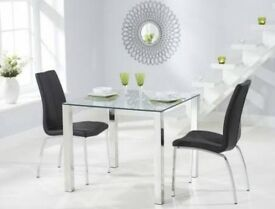 X4 black chairs and glass table
