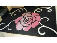 Large Rug in good condition. 89 inch X 62 inch, £30 ono