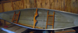 EUC 12 foot fiberglass canoe and paddles
