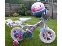 Childs first bike and helmet good condition seldom used £25.