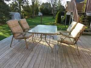 Patio table and 4 chairs with cushions