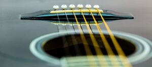 Ajustement & réparation de guitare acoustique & classique