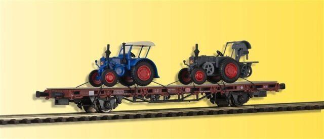 Kibri 26252 Niederbordwagen mit zwei Lanzbuldogs, Fertigmodell, H0