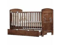 Lovely solid cot bed, little wear and tear