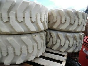 Non-marking skid steer tires – NEW set of 4 $1300