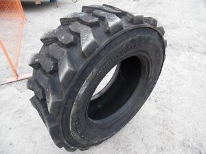 15 X 19.5 skid steer or backhoe or loader tire – New, half price