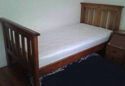 2 solid timber single bed frames with mattresses
