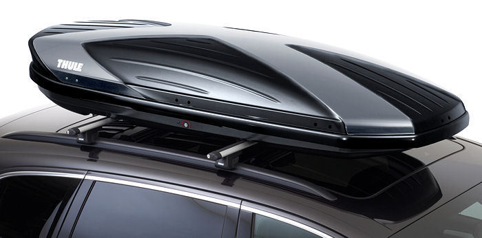 A premium branded roof box perfectly fitted to a roof-top.