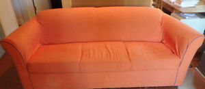 Contemporary cool orange couch with hide-a-bed