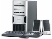 gateway pc and moniter, with keyboards and mouse.