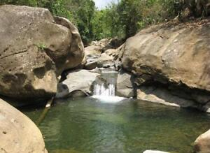 Costa Rica humble home on 11.8 acres of land with river frontage