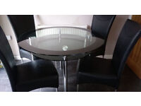 Glass round table from Harveys