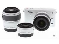 Nikon J1 Digital Camera kit with 10-30mm & 30-110mm lenses. Like new and unused.