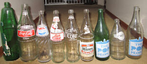 Close to 50 vintage glass pop bottles from he 60's 70's and 80's