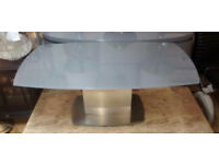 Flow Modern Curved Grey Glass and Steel Coffee Table.