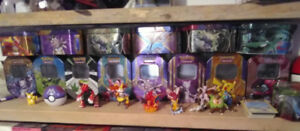 Pokemon card collection.  With tin,  toy,  pin and coin