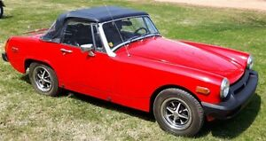 1976 MG midget convertible and 1990 Mercury Capri convertible mi