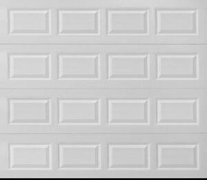 NEW - 9x7 INSULATED garage door.  COMPLETE, NEVER INSTALLED.