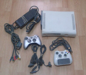 Xbox 360 Console w/ 2 controllers and hookups.