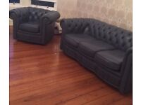 Antique blue leather chesterfield sofa and chair group.