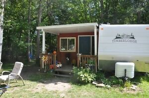 39 ft Timberlodge trailer for sale with sun room at McGowan Lake