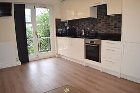Refurbished two double bedroom flat to let with a private patio in Barons Court.