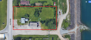 1 acre by Stanley ave and portage. needs a regular cut !!