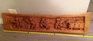 Wooden carving. Mining scene