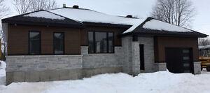 Maison plein-pied avec 4 chambres et garage a vendre