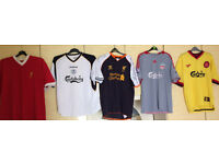 Liverpool FC replica tops and other official merchandise.
