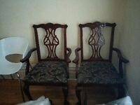 2 mohagony antique captain chairs