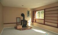 Cute, Garden 1-Bdrm Suite with Wood Stove in Living Room